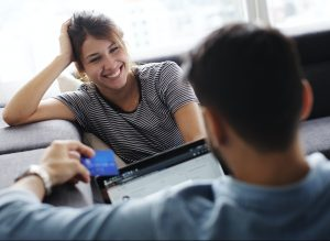 couple-buying-online-with-credit-card-and-computer